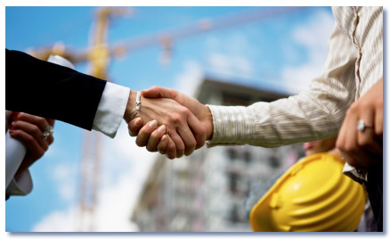 Shaking hands on a construction site.